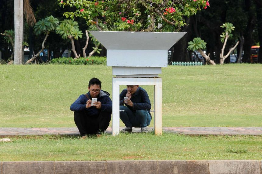 People play the mobile phone game Pokemon Go in a park in Central Jakarta, Indonesia, on July 21.
