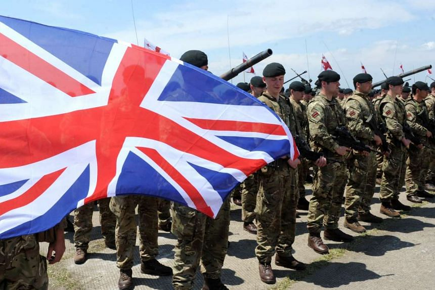 British servicemen with the British flag at the opening ceremony for a joint military exercise near Tbilisi, Georgia, on May 11, 2016.