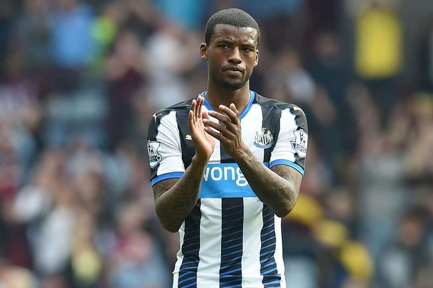 Newcastle United's Dutch midfielder Georginio Wijnaldum applauds supporters on the pitch in May 2016.