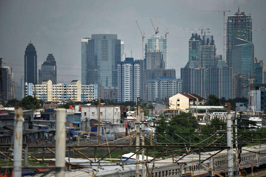 A general view shows under-construction buildings among the city skyline in Jakarta on June 30.
