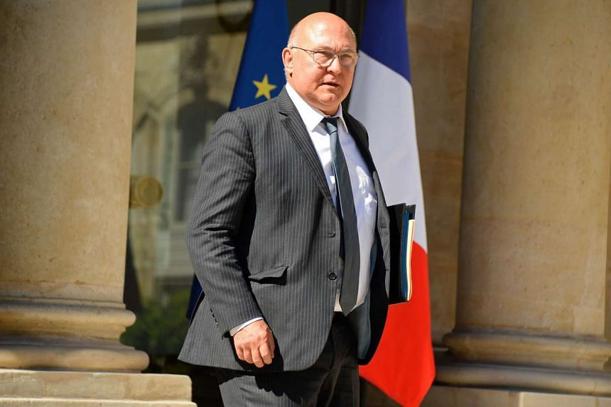 French Finance Minister Michel Sapin leaves a Cabinet meeting at the Elysee Presidential Palace in Paris, on July 19, 2016.