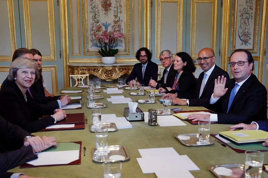 French President Francois Hollande (right) meets with Britain's Prime Minister Theresa May (left) on July 20 at the Elysee Palace in Paris.