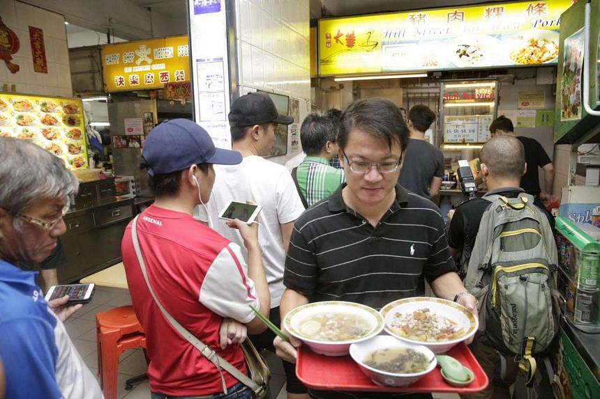 The lunchtime queue at Michelin-starred Hill Street Tai Hwa Pork Noodle on July 22, 2016.
