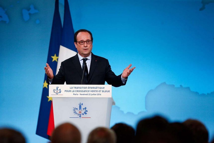 French President Francois Hollande gives a speech during a ceremony marking the first anniversary of the energy transition law, at the Elysee Palce, in Paris, France on July 22.
