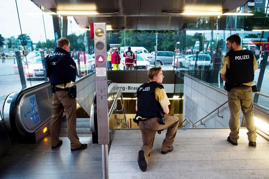 Police secure the entrance to a subway station near a shopping mall where a shooting took place on July 22, 2016 in Munich.