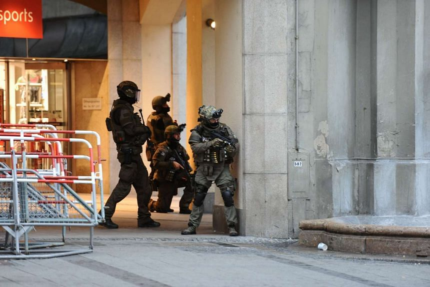Police secure the area of a subway station Karlsplatz (Stachus) near a shopping mall following a shooting on July 22, 2016 in Munich.