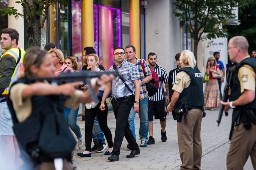 Police evacuate people from the shopping mall in Munich on July 22, 2016 following a shootings earlier.