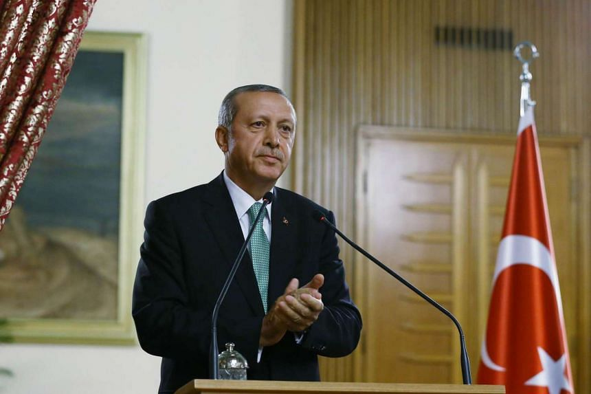 Turkey's President Recep Tayyip Erdogan speaks at the Ceremony Hall of the Grand National Assembly in Ankara, on July 22, 2016.