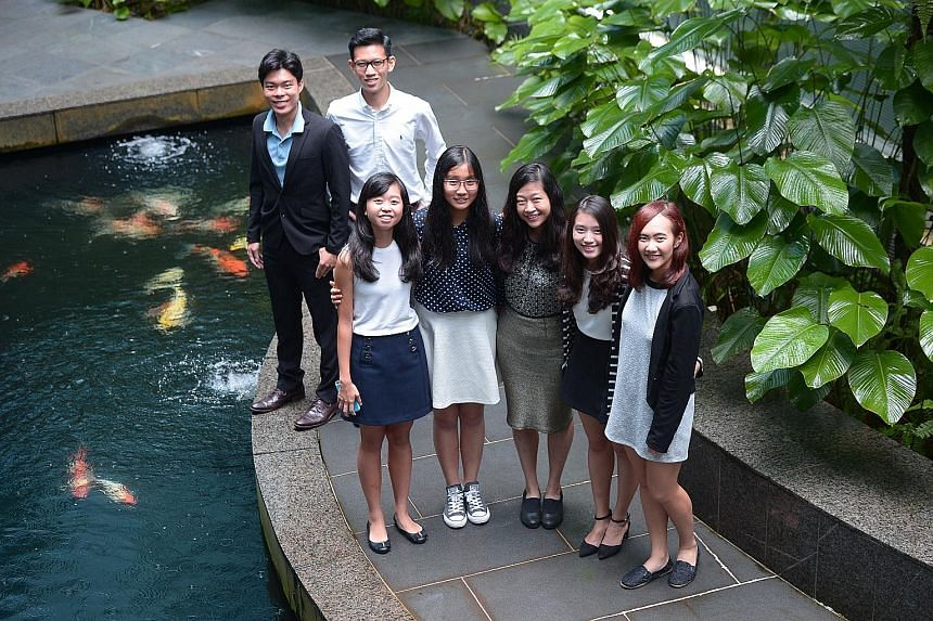 Journalism scholarship recipients (back row, from left) Clement Yong, 21; Ng Keng Gene, 21; (front row) Miss Wong Shiying, 19; Miss Ang Qing, 19; Miss Jessie Lim, 19; Miss Lee Geng Wei, 19; and Miss Zhang Xi Ying, 19.