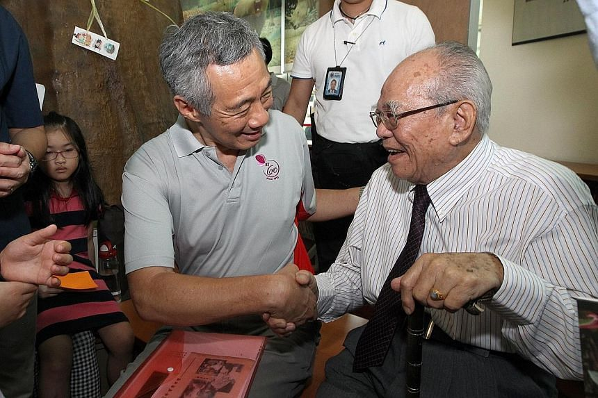 PM Lee with Mr Chor at the 60th Anniversary of Bukit Timah celebrations last year. Mr Lee said that Mr Chor, as MP for Bukit Timah, saw the poor neighbourhood turn into a beautiful modern estate, and improved the lives of residents.