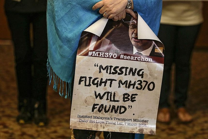The wife of an MH370 crew member at a press conference ahead of the MH370 Ministerial Tripartite Meeting in Kuala Lumpur yesterday. The plane vanished on March 8, 2014 with 239 people on board