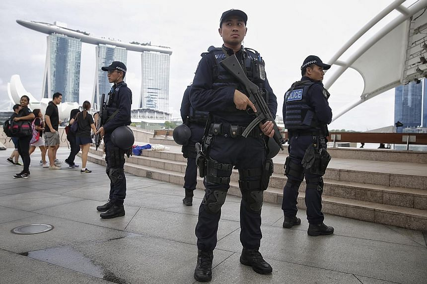 Officers of the new Emergency Response Teams on patrol at the Esplanade area yesterday. Since last month, these ERT officers, who are specially trained in counter-assault skills and armed with HK-MP 5 submachine guns, have been patrolling public area