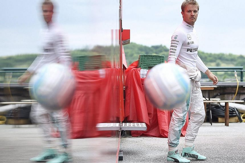 Mercedes' Nico Rosberg playing with a football prior to yesterday's first practice session of the Hungarian Grand Prix.