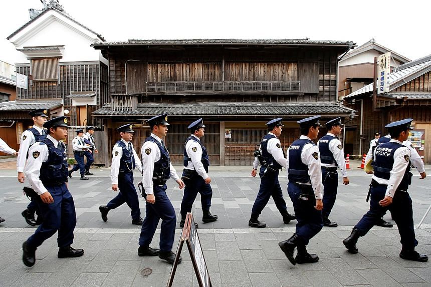 Policemen ahead of the G-7 summit in Japan in May. Experts say there is general apathy at home about the terror threat.