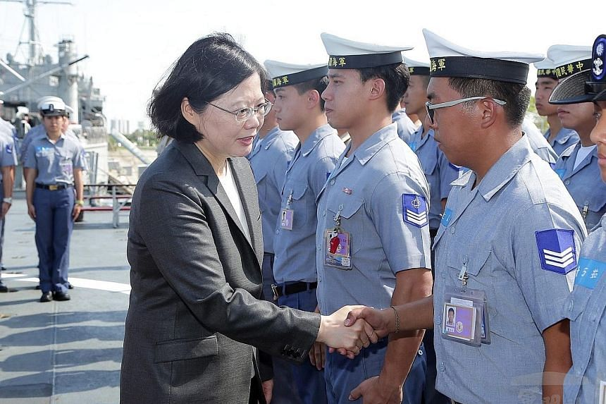 """Taiwanese President Tsai Ing-wen on a warship on July 13 before it sailed to the South China Sea on a patrol mission. China said that peaceful ties can be guaranteed only by upholding the """"one China"""" principle."""