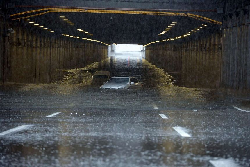 Cars being submerged by floodwater in Beijing on July 20.