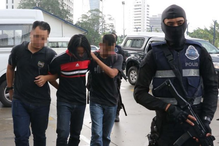 One of the 14 suspected ISIS militants detained, in a photo provided by the Royal Malaysia Police.