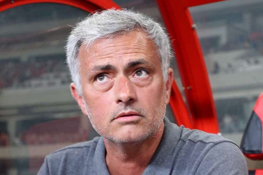 Manchester United manager Jose Mourinho watches the match in China.