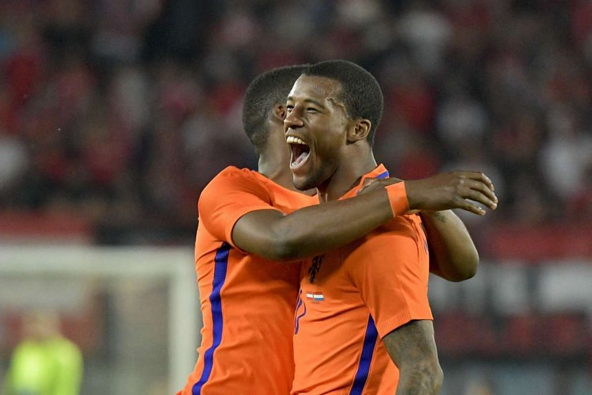 Austria's Giorginio Wijnaldum celebrates after scoring the lead during the Euro 2016 friendly football match against Netherlands in Vienna, on June 4, 2016.