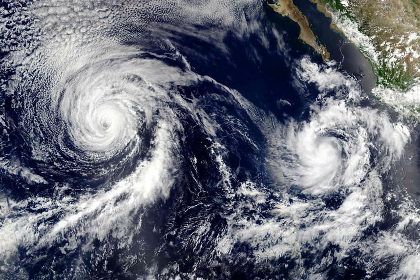 A Nasa satellite image on July 12, 2016, shows Hurricane Celia (left) and Tropical Storm Darby churning in the Pacific Ocean.