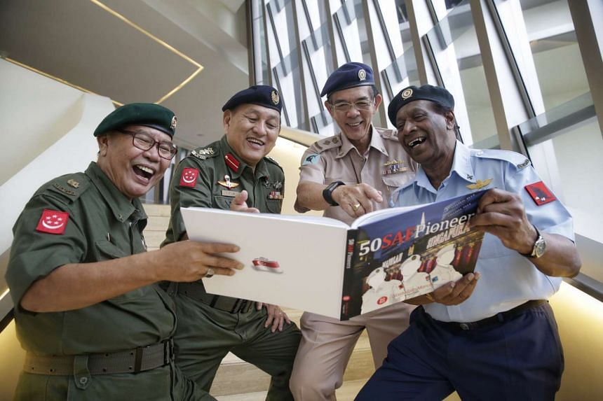 SAF pioneers browse the 50 SAF Pioneers' Nostalgic March - 9 August 2015 book on July 23, 2016.