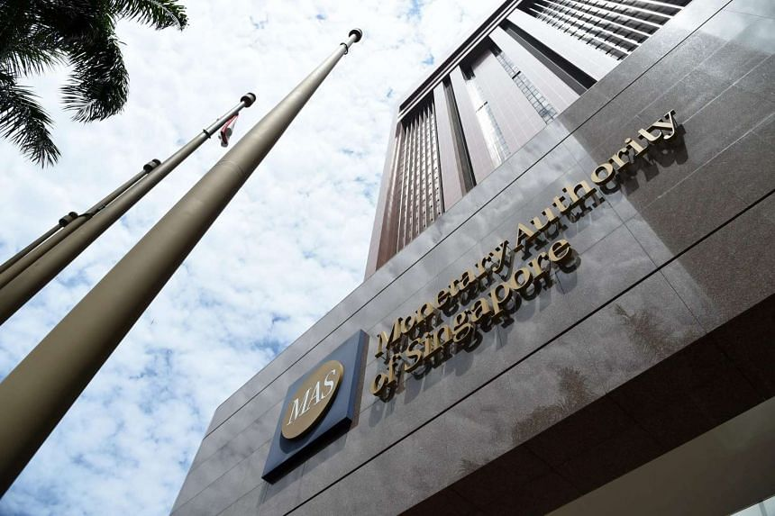 The logo of the Monetary Authority of Singapore is seen on its main building in Singapore on May 24.