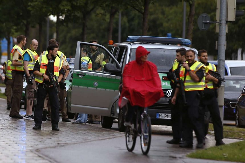 Police secure a street near to the scene of a shooting in Munich, Germany July 22, 2016.