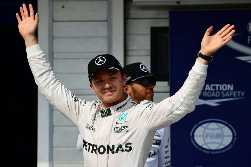 Nico Rosberg (left) celebrates his pole position.