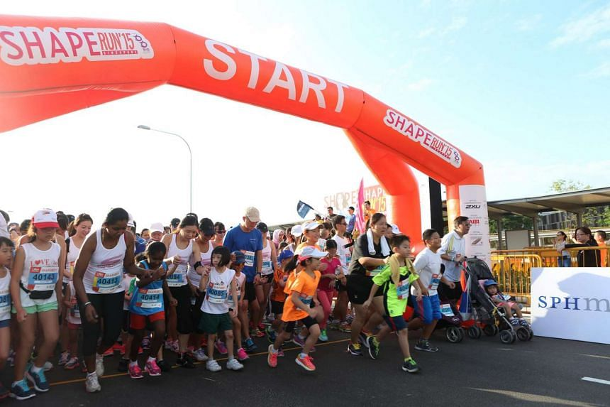Participants set off in a 1.8km Family Fun Run at the Shape Run on July 26, 2015.
