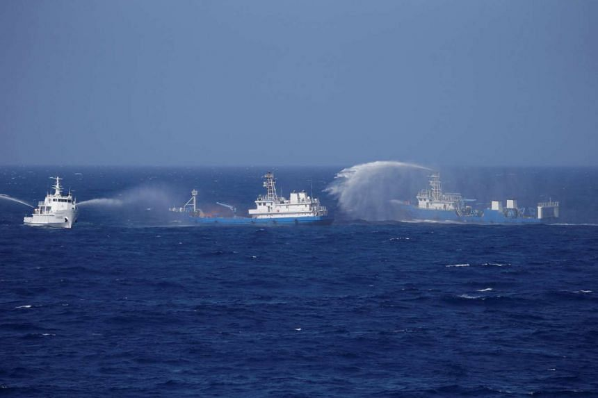 Chinese ships are seen during a search and rescue exercise near Qilian Yu subgroup in the Paracel Islands, South China Sea on July 14.
