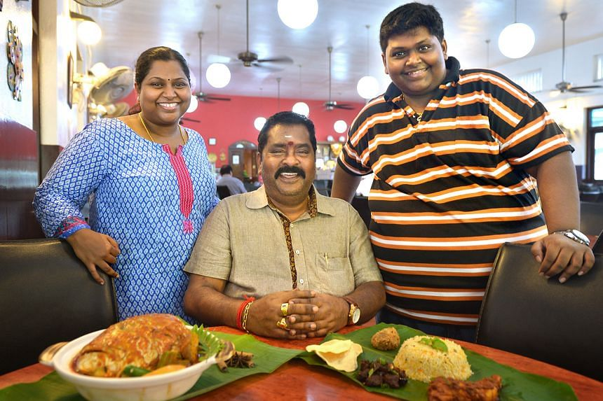The masala chicken of Samy's Curry Restaurant owner V. Maheyndran (centre, with his daughter Nagajyothi Mahendran and son M. Veerasamy) is a shortlisted dish.
