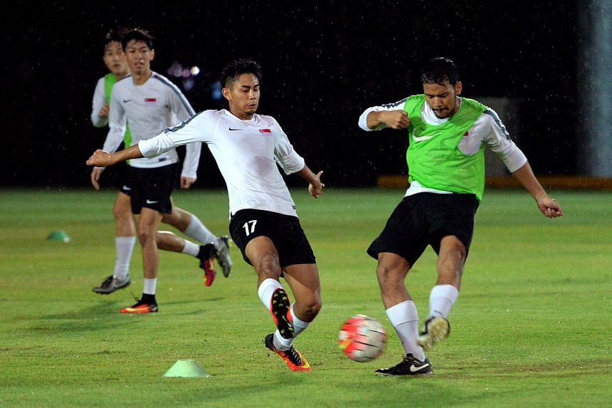 Adam Swandi (left) challenging Hafiz Sulaiman for the ball during the Singapore Under-21 team's training yesterday. They will play Iran at Bishan Stadium tonight.