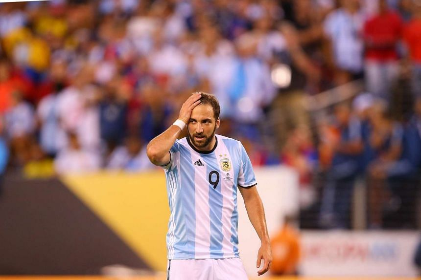 Juventus are set to smash Italy's transfer record by snatching striker Gonzalo Higuain (above) from Napoli after triggering his release clause of €94.7 million.