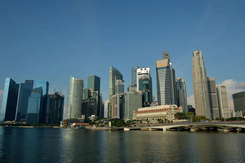 Singapore's Central Business District (CBD) reflected against Marina Bay.