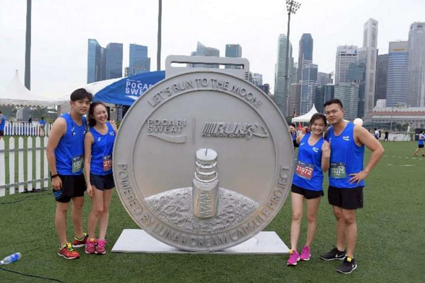 Participants posing at the photo-taking zone during the Pocari Sweat Run 2016.