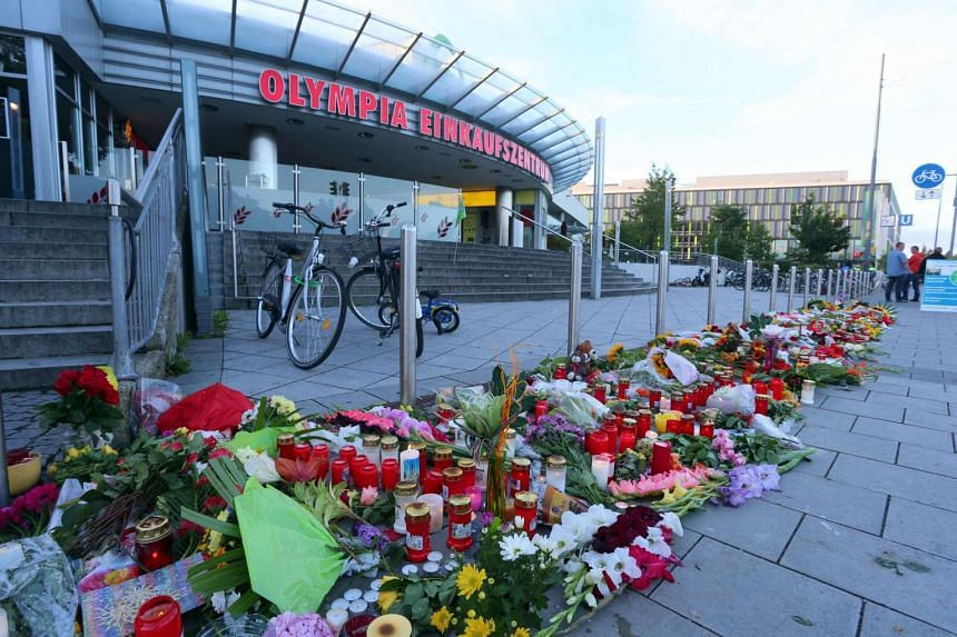 Flower and candles are seen at a memorial in front of the Olympia Einkaufszentrum shopping centre in Munich, after the terror attack, on July 24, 2016.