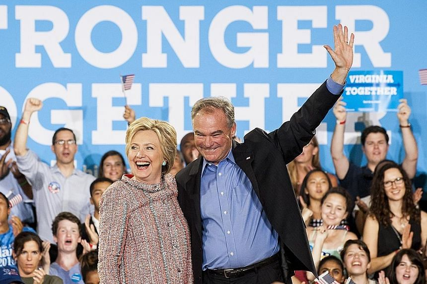 "Mrs Clinton campaigning with Mr Kaine in Virginia earlier this month. The presumptive Democratic nominee for the US presidency has chosen Mr Kaine as her running mate, praising the Virginia senator as a ""lifelong fighter for progressive causes""."