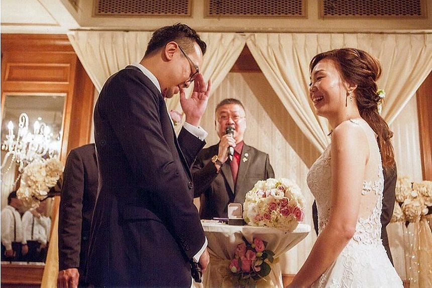 Mr Lim (centre) solemnising the marriage of Mr Jeremy Si, 32, and Ms Hazel Ng, 31, this year. The 49-year-old is one of nearly 200 grassroots leaders who, since 1992, have been authorised to solemnise marriages.