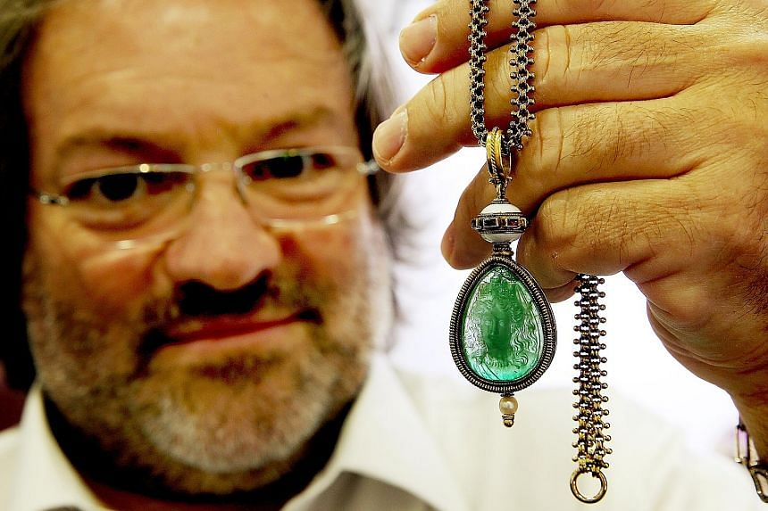 Mr Sciaguato holding up the 55-carat emerald pendant which was a gift from Napoleon III to his lover, the Countess of Castiglione.