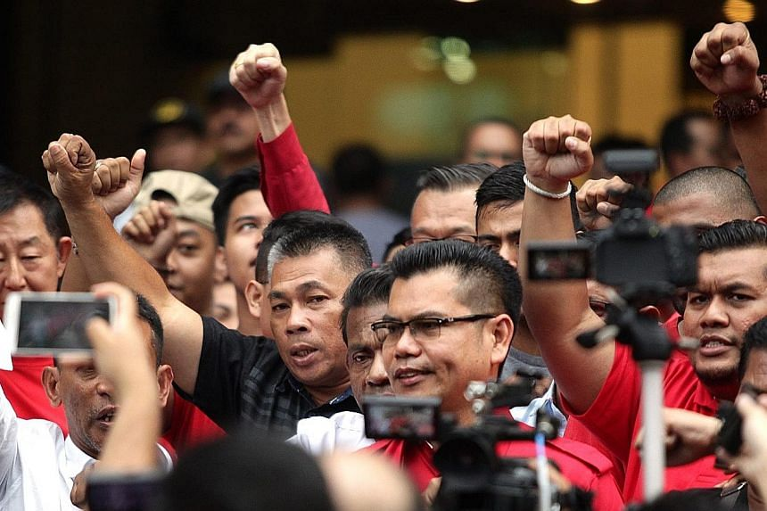Mr Jamal (wearing glasses) talking to the press in Kuala Lumpur yesterday. He said the next Red Shirt rally, if it were to happen, would draw a much larger crowd than that of pro-reform group Bersih.