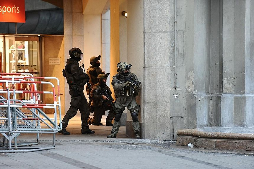 (Left) Police securing a subway station near the mall where Sonboly (above) started his attack. He had a gun and 300 rounds in a rucksack. He was later found with a shot to the head.