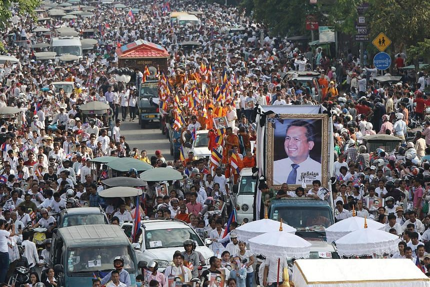 People attend the funeral procession of Cambodian independent political analyst Kem Ley in Phnom Penh, Cambodia, on July 24.