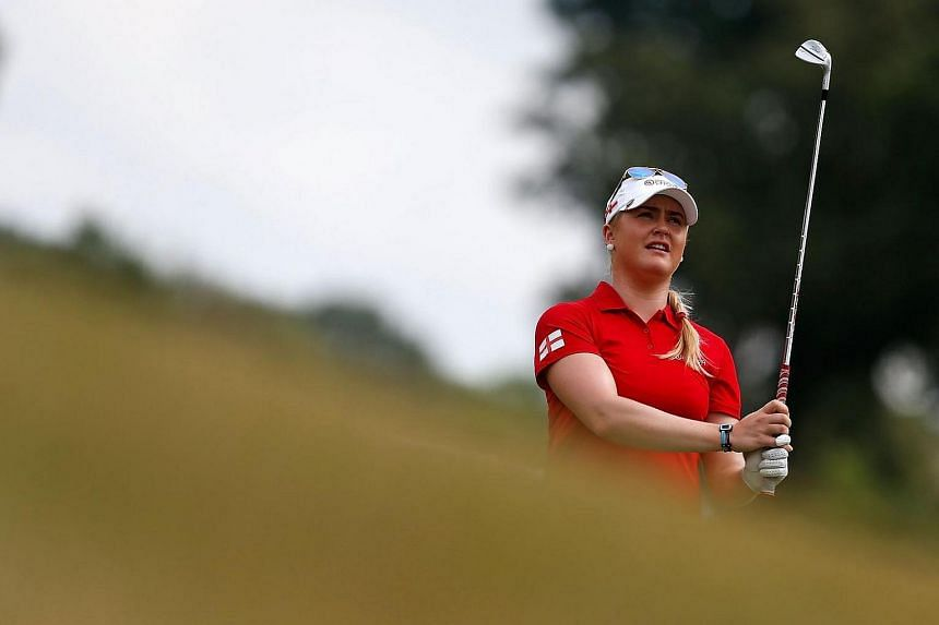 Charley Hull of England watches her approach shot on the first hole during the four-ball session of the 2016 UL International Crown on July 23.