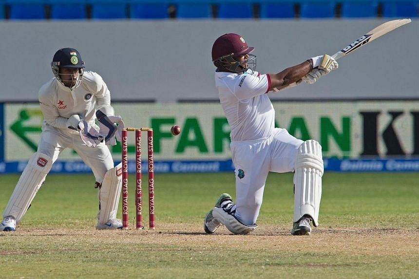 West Indies cricketer Shannon Gabriel (right) misses the ball bowled by India cricketer Amit Mishra during day three of the cricket test match between West Indies and India on July 23.