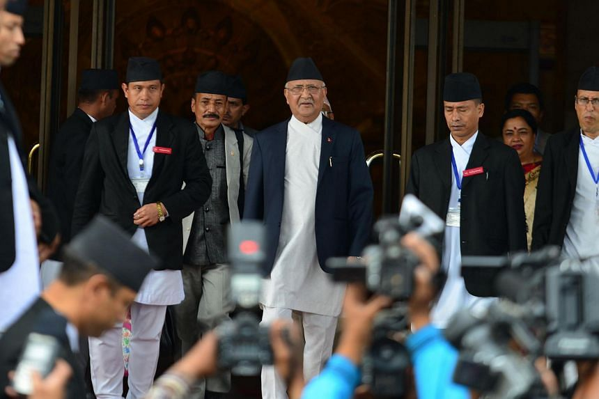 Nepalese Prime Minister KP Oli Sharma (centre) leaves the Parliament Building in Kathmandu on July 21.