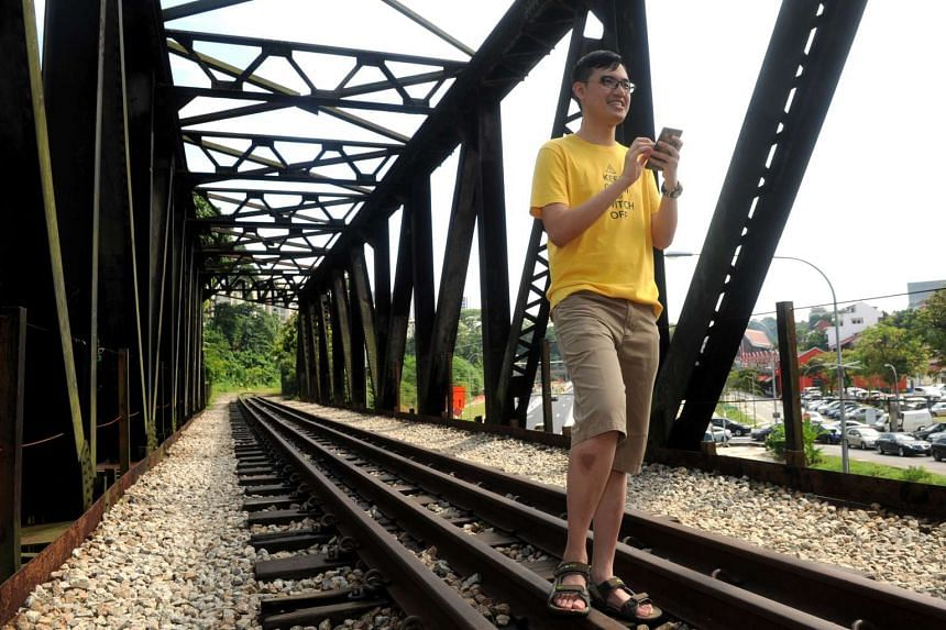 "Mr Tan on the railway track near Rail Mall, which was one of two Pokemon Go ""gyms"" he spotted near his home when he downloaded the game."