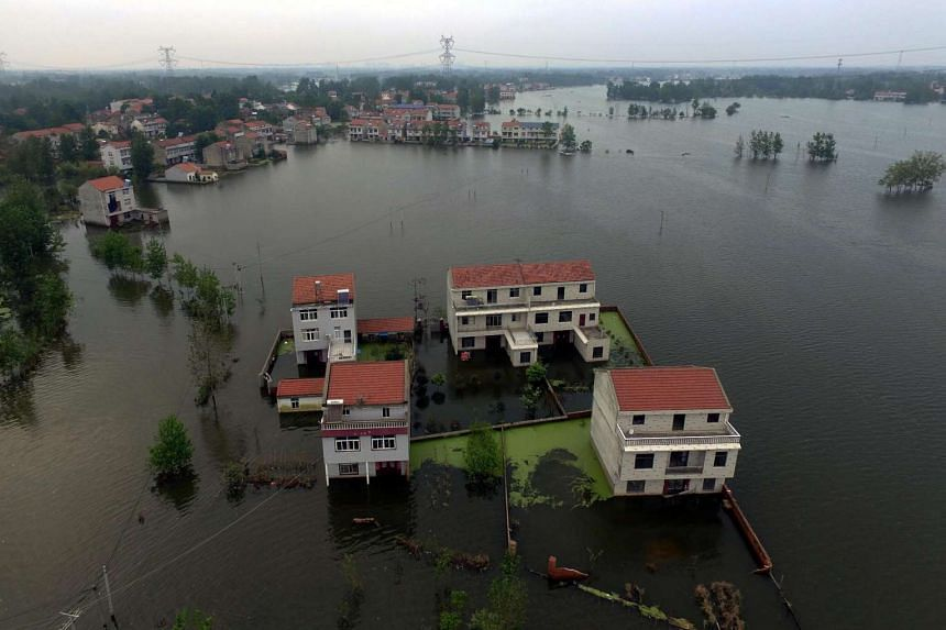 An aerial view of waters flooding Xinhua Village of Xinchang county in Wuhan city, Hubei Province of central China on July 28, 2016.