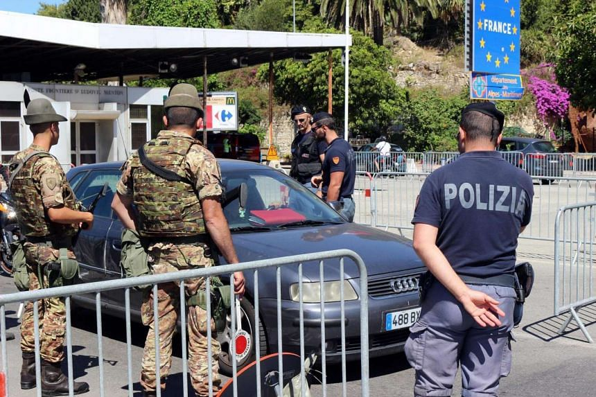 Italian police and soldiers checking vehicles at the border checkpoint in Ventimiglia, next to the border with France, on July 15, 2016.