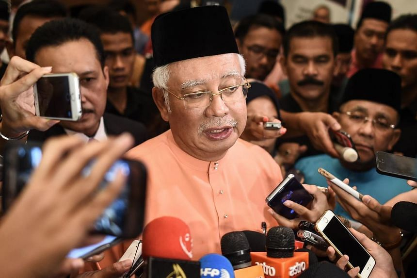 Malaysia's Prime Minister Najib Razak speaks to members of the media after an event in Kuala Lumpur on July 21, regarding the 1MDB saga.