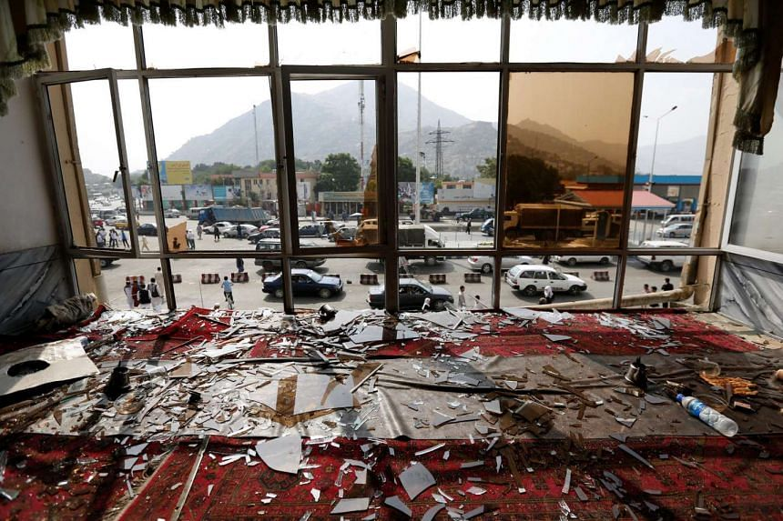 Broken glass and debris in a resturant in Kabul, Afghanistan, on July 24, 2016, a day after a suicide attack.